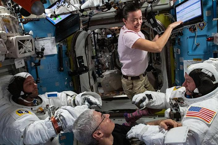 European Space Agency astronaut Thomas Pesquet, left, and NASA crewmate Shane Kimbrough, right, test the spacesuits they'll use for a planned outing Wednesday to install new solar panels on the International Space Station. Megan McArthur, top, and Mark Vande Hei, bottom, assist. / Credit: NASA  - ebbdd5d455e2a17043b8c5f8bdf2fec0 - Space station gets new solar arrays in spacewalk
