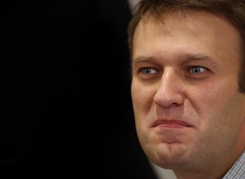 Russian opposition leader Alexei Navalny grimaces as he listens in a court room in Kirov, Russia, Wednesday, Oct. 16, 2013. A Russian courthouse in Kirov set Navalny free in July, the day after he was convicted of embezzlement and sentenced to five years in prison. Navalny has appealed both the conviction and the sentence. (AP Photo/Evgeny Feldman)
