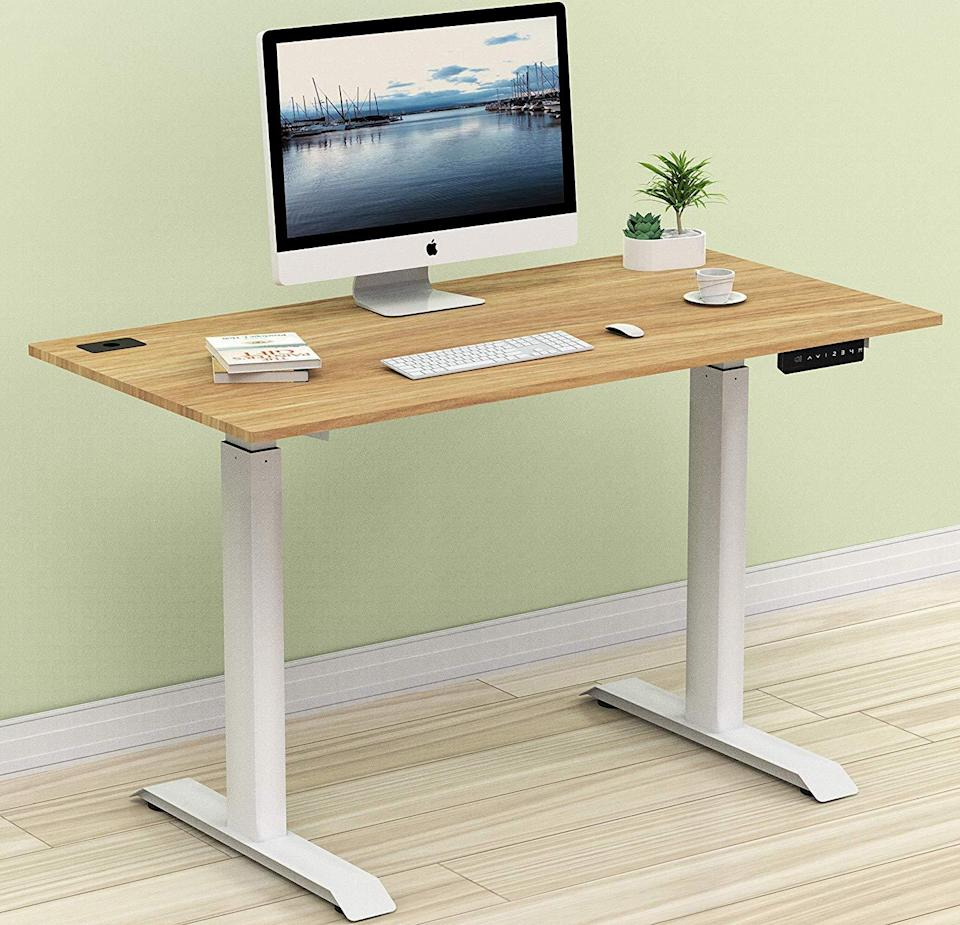 """<h3><strong>Standing Desk Under $250</strong></h3><br><br>This desk offers an electric lift system and is fully motorized and able to lift from 31 to 41 inches. It also offers four different memory preset options for quick and easy height changes. Its sleek design and functionality makes it a great option for someone who wants easy access to variable desk heights throughout the workday.<br><br><strong><a href=""""https://www.amazon.com/SHW-Electric-Height-Adjustable-Computer/dp/B07GVRKCWP/ref=sr_1_fkmrnull_3?keywords=shw+standing+desk&qid=1556219969&s=gateway&sr=8-3-fkmrnull"""" rel=""""nofollow noopener"""" target=""""_blank"""" data-ylk=""""slk:What people are saying"""" class=""""link rapid-noclick-resp"""">What people are saying</a></strong>: """"I have severe degenerative disk disease in my lower back and cannot sit for very long, which is very inconvenient for my desk job. I love this desk! It's sturdy, it's pretty, it fits all of my work equipment — 2 large monitors and my laptop, dock, keyboard, mousepad planner. It's really well built!""""<br><br><strong>SHW</strong> SHW Electric Height Adjustable Computer Desk, $, available at <a href=""""https://www.amazon.com/SHW-Electric-Height-Adjustable-Computer/dp/B07GVRKCWP/ref=sr_1_5?keywords=standing+desk&qid=1556219521&refinements=p_72%3A2661619011&rnid=2661617011&s=gateway&sr=8-5"""" rel=""""nofollow noopener"""" target=""""_blank"""" data-ylk=""""slk:Amazon"""" class=""""link rapid-noclick-resp"""">Amazon</a>"""