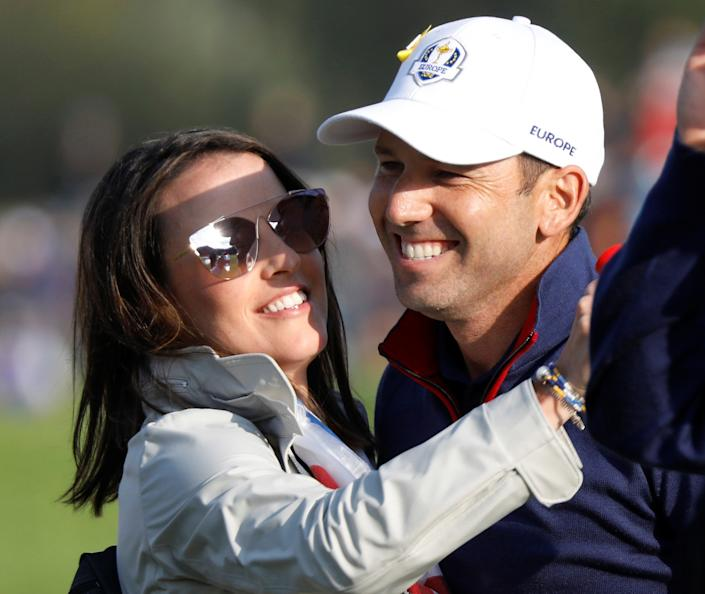 Team Europe's Sergio Garcia celebrates with spouse Angela Garcia after winning his Foursomes match with partner Alex Noren against Team USA's Phil Mickelson and Bryson DeChambeau  REUTERS/Charles Platiau
