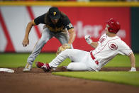 Pittsburgh Pirates' shortstop Cole Tucker (3) tags out Cincinnati Reds' Tyler Mahle (30) during the second inning of a baseball game in Cincinnati, Tuesday, Sept 21, 2021. (AP Photo/Bryan Woolston)
