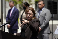 Acting United States Attorney Tracy Wilkison, center, fields questions outside the Edward R. Roybal Federal Building, Thursday, May 13, 2021, in Los Angeles. Federal authorities say they have arrested at least 10 suspected drug dealers accused of selling fentanyl and other opioids that led to overdose deaths. (AP Photo/Marcio Jose Sanchez)