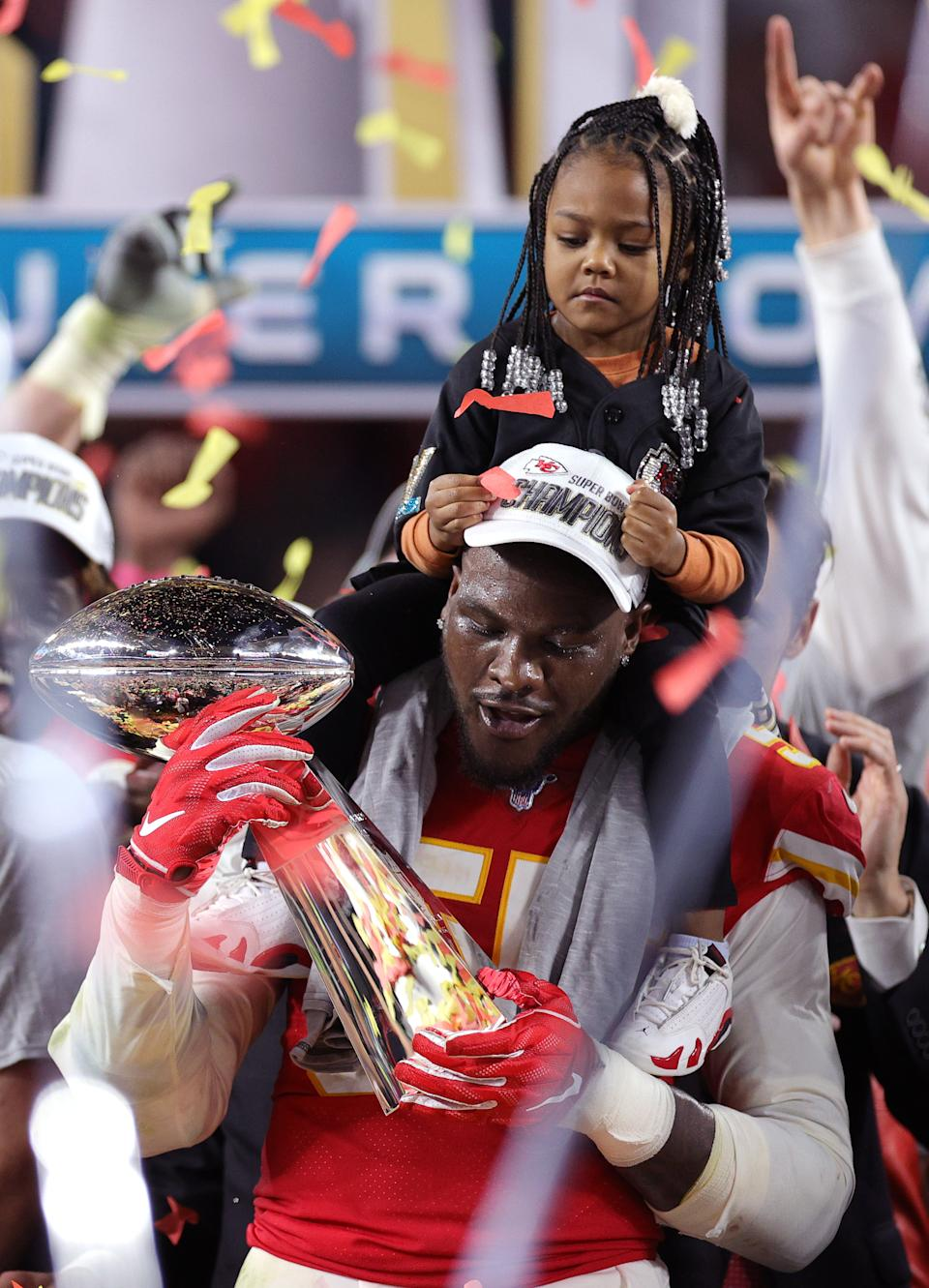 MIAMI, FLORIDA - FEBRUARY 02: Frank Clark #55 of the Kansas City Chiefs holds the the Vince Lombardi trophy after defeating the San Francisco 49ers 31-20 in Super Bowl LIV at Hard Rock Stadium on February 02, 2020 in Miami, Florida. (Photo by Rob Carr/Getty Images)