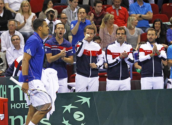 French tennis player Jo-Wilfried Tsonga gets encouragement from teammates during his single match against German player Tobias Kamke, in the quarterfinals of the Davis Cup between France and Germany, in Nancy, eastern France, Sunday, April 6, 2014. (AP Photo/Remy de la Mauviniere)