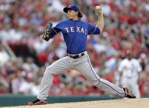 Texas Rangers starting pitcher Derek Holland throws during the first inning of a baseball game against the St. Louis Cardinals on Friday, June 21, 2013, in St. Louis. (AP Photo/Jeff Roberson)