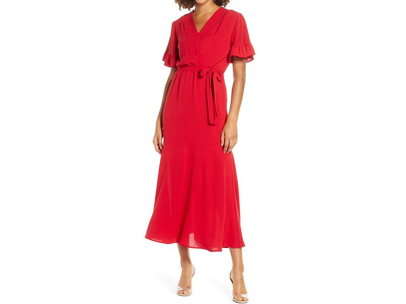 """Davignon says a midi dress is """"always in style"""" and this holiday season is no exception. """"Slightly longer silhouettes that hit at mid-calf length elongate the frame, while asymmetric cutouts, ruffles and hemlines create visual interest that feels fresh for the season."""" (Photo: Nordstrom) <a href=""""https://fave.co/35bl1Of"""" rel=""""nofollow noopener"""" target=""""_blank"""" data-ylk=""""slk:SHOP IT:"""" class=""""link rapid-noclick-resp""""><strong>SHOP IT: </strong></a><strong>Fraiche by J Ruffle Sleeve Faux Wrap Dress, $110, </strong><a href=""""https://fave.co/35bl1Of"""" rel=""""nofollow noopener"""" target=""""_blank"""" data-ylk=""""slk:nordstrom.com"""" class=""""link rapid-noclick-resp""""><strong>nordstrom.com</strong></a>"""