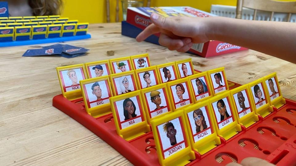 Two children playing Guess Who?