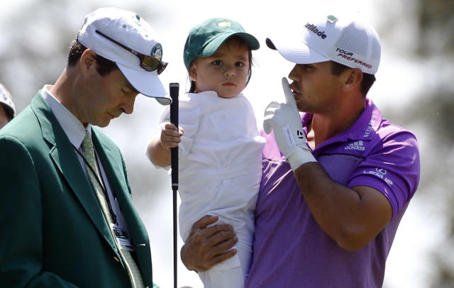 Australian golfer Jason Day quiets his son Dash on the first hole of the Par 3 contest ahead of the Masters golf tournament at the Augusta National Golf Club in Augusta, Georgia April 9, 2014. REUTERS/Mike Segar (UNITED STATES - Tags: SPORT GOLF)