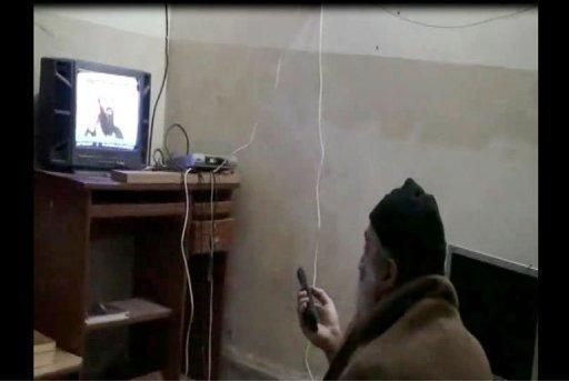 A still from a US Department of Defense(DoD) video shows former Al Qaeda leader Osama bin Laden watching himself on television. The death of their figurehead and US drone attacks in the Pakistani highlands have disrupted Al-Qaeda's core guerrilla organisation, now reduced to a few dozen militants battling for their own survival, experts say