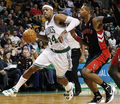 Boston Celtics forward Paul Pierce (34) drives against Toronto Raptors forward James Johnson (2) in the first quarter of an NBA basketball game in Boston, Wednesday, Jan. 18, 2012. (AP Photo/Elise Amendola)