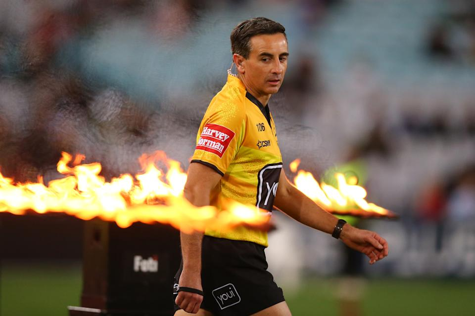 Gerard Sutton (pictured) walks onto the field to referee an NRL match.