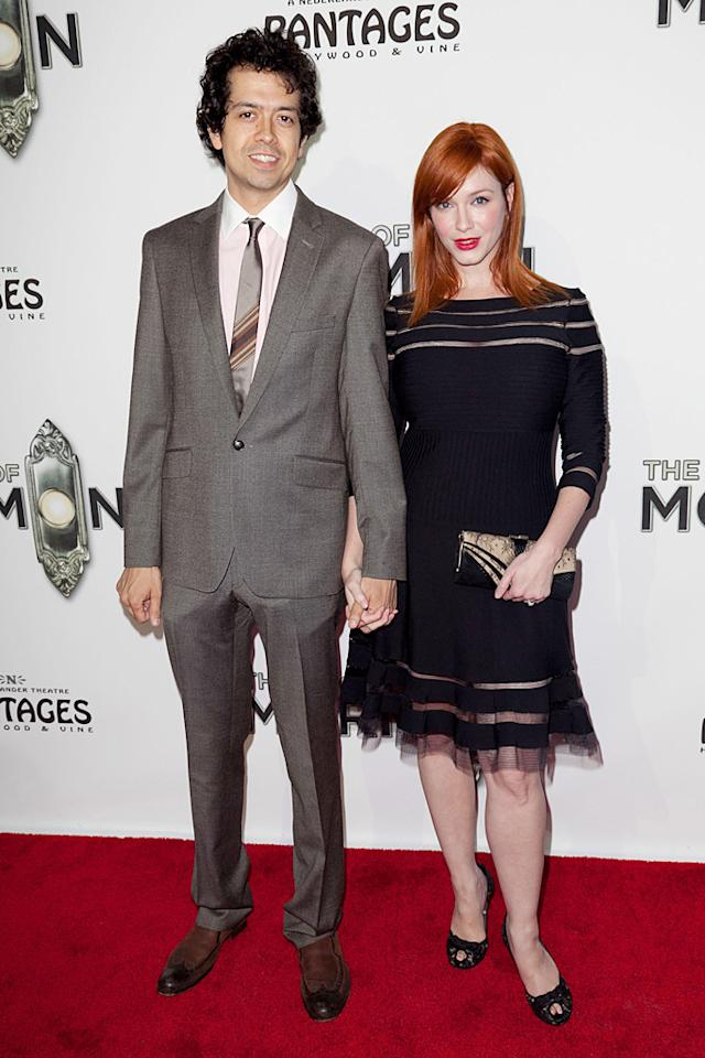 """Mad Men"" actress Christina Hendricks' husband Geoffrey Arend looked straight out of the '60s in his gray suit and striped tie, while the voluptuous redhead covered up her curves. Maybe because ""The Book of Mormon"" is a religion-themed comedy? (9/12/2012)"