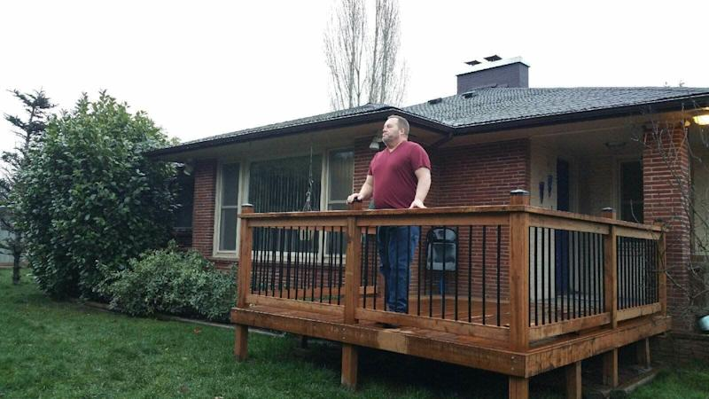 William Pump, a project coordinator for the FAA stands on the deck of his home in Vancouver, WA. He and his wife Suzette fear they might lose their home if this shutdown continues. Photo: Suzette Pump