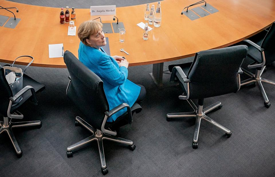 German Chancellor Angela Merkel is seated prior to testifying in front of a parliamentary committee investigating the financial scandal over payment systems provider Wirecard in Berlin, on April 23, 2021. - Chancellor Merkel will be quizzed on April 23 over her role in the scandal after it emerged she promoted Wirecard on a trip to China in September 2019 when the firm was eyeing a foray into the Chinese market. Once a rising star in the booming fintech sector, Wirecard filed for bankruptcy last year after admitting that 1.9 billion euros (USD 2.3 billion) was missing from its accounts. Lawmakers are investigating the political and regulatory failings that allowed the Wirecard cheating to go unnoticed for years, with critics saying early warning signs were ignored. (Photo by Michael Kappeler / POOL / AFP) (Photo by MICHAEL KAPPELER/POOL/AFP via Getty Images) (Photo: MICHAEL KAPPELER via Getty Images)