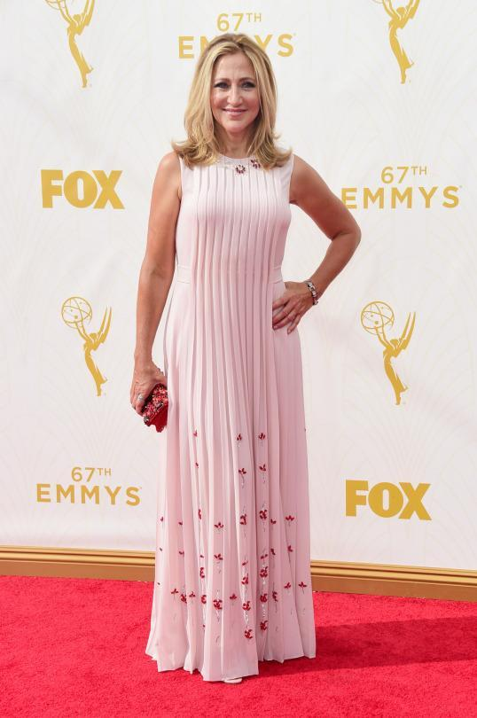 """<p>Edie Falco traded her """"Nurse Jackie"""" scrubs for a pink Prada dress and the pale pink gown's certainly a better fit for her than the light blue cotton separates. The gown, an iteration from the same collection seen on every September magazine cover, had pleats cascading from the neckline and little beaded flowers throughout the skirt.<br></p>"""