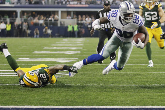Green Bay Packers strong safety Morgan Burnett (42) stops Dallas Cowboys wide receiver Dez Bryant (88) short of the goal line during the first half of an NFL football game, Sunday, Dec. 15, 2013, in Arlington, Texas. (AP Photo/Tim Sharp)