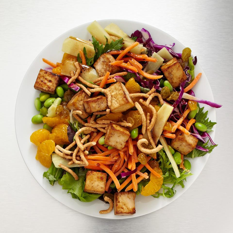 <p>Craving crunch? Bite into this salad loaded with crisp red cabbage, edamame, bamboo shoots, and chow mein noodles. This salad is slightly sweetened with baked tofu, mandarin oranges, and Asian sesame vinaigrette.</p>