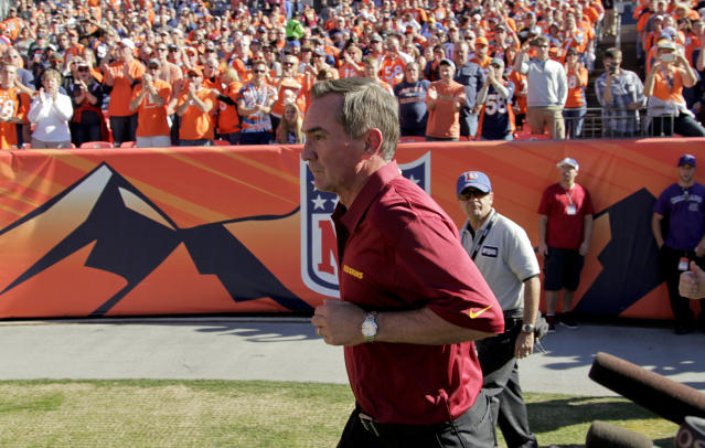 Washington Redskins coach Mike Shanahan runs out onto the field before the start an NFL football game against the Denver Broncos, Sunday, Oct. 27, 2013, in Denver. (AP Photo/Joe Mahoney)