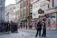 Police officers secure the area where multiple people were stabbed in Quebec City