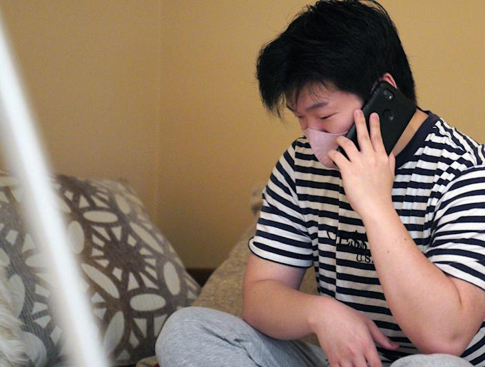 Randy Park, 22, talks on the phone on Friday, March 19, 2021, following the death of his mother, Hyun Jung Grant, in a series of shootings at Asian spas in the Atlanta area.