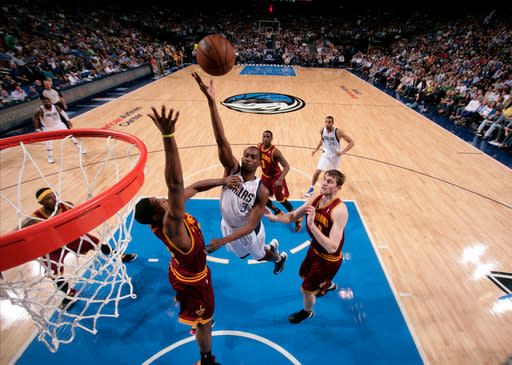 DALLAS, TX - MARCH 15: Rodrigue Beaubois #3 of the Dallas Mavericks shoots against Tristan Thompson #13 of the Cleveland Cavaliers on March 15, 2013 at the American Airlines Center in Dallas, Texas. (Photo by Glenn James/NBAE via Getty Images)