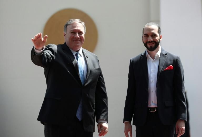 US Secretary of State Mike Pompeo waves next to Salvadoran President Nayib Bukele (R) upon arrival for a meeting at the presidential residence in San Salvador (AFP Photo/MARVIN RECINOS)
