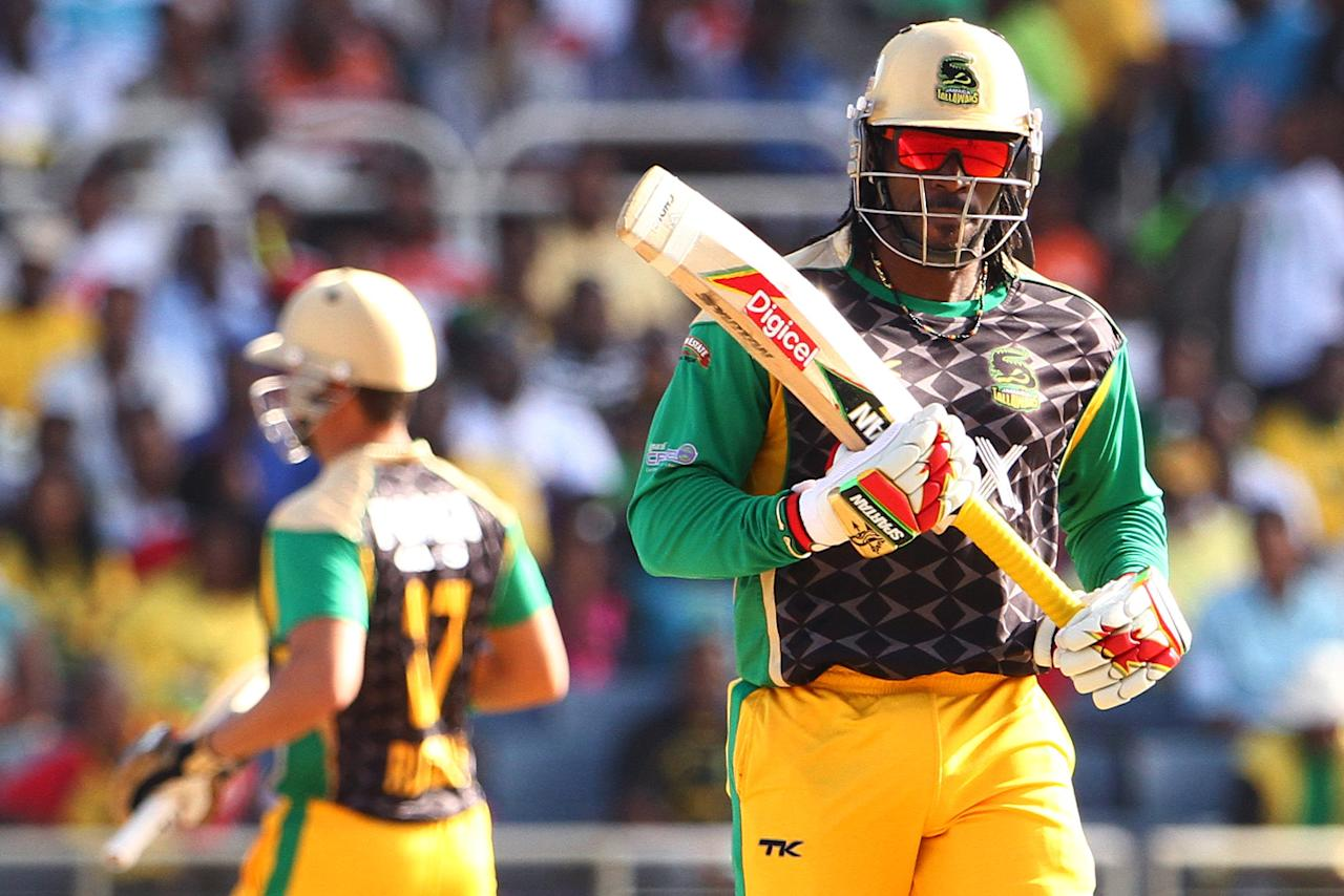 KINGSTON, JAMAICA - AUGUST 15: Chris Gayle runs between the wickets during the Sixteenth Match of the Cricket Caribbean Premier League between Jamaica Tallawahs v Guyana Amazon Warriors at Sabina Park on August 15, 2013 in Kingston, Jamaica. (Photo by Ashley Allen/Getty Images Latin America for CPL)