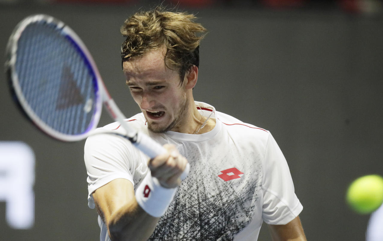 Daniil Medvedev of Russia returns the ball to Joao Sousa of Portugal during the St. Petersburg Open ATP tennis tournament match in St.Petersburg, Russia, Tuesday, Sept. 18, 2018. (AP Photo/Dmitry Lovetsky)