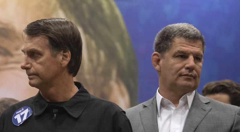 Brazil's right-wing presidential candidate for the Social Liberal Party (PSL) Jair Bolsonaro (L) and President of the Social Liberal Party (PSL) Gustavo Bebianno Rocha (R) gesture during a press conference at Windsor Barra Hotel in Rio de Janeiro, Brazil on October 11, 2018. (Photo by Mauro Pimentel / AFP) (Photo credit should read MAURO PIMENTEL/AFP via Getty Images)