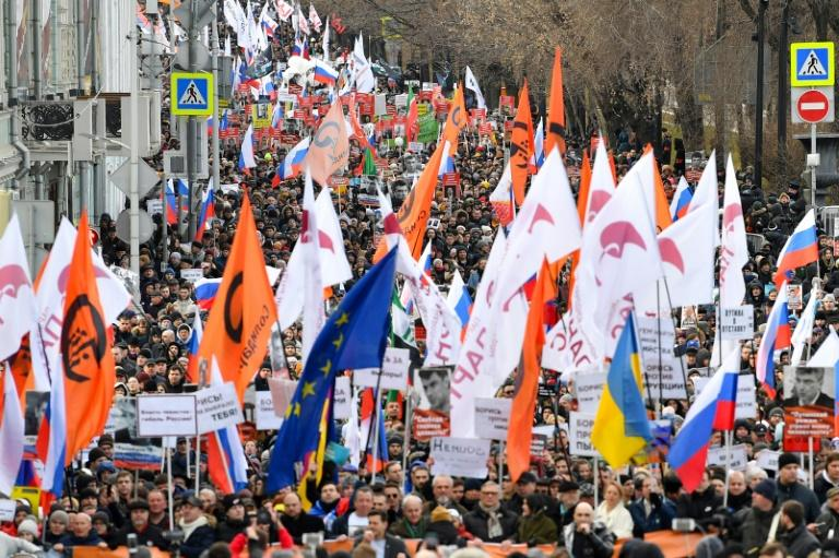 Opposition supporters march in memory of murdered Kremlin critic Boris Nemtsov in downtown Moscow on February 29, 2020