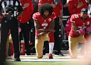 In this file photo taken on October 23, 2016, Colin Kaepernick (C) and Eric Reid (R) of the San Francisco 49ers kneel in protest during the national anthem prior to an NFL game (AFP Photo/EZRA SHAW)