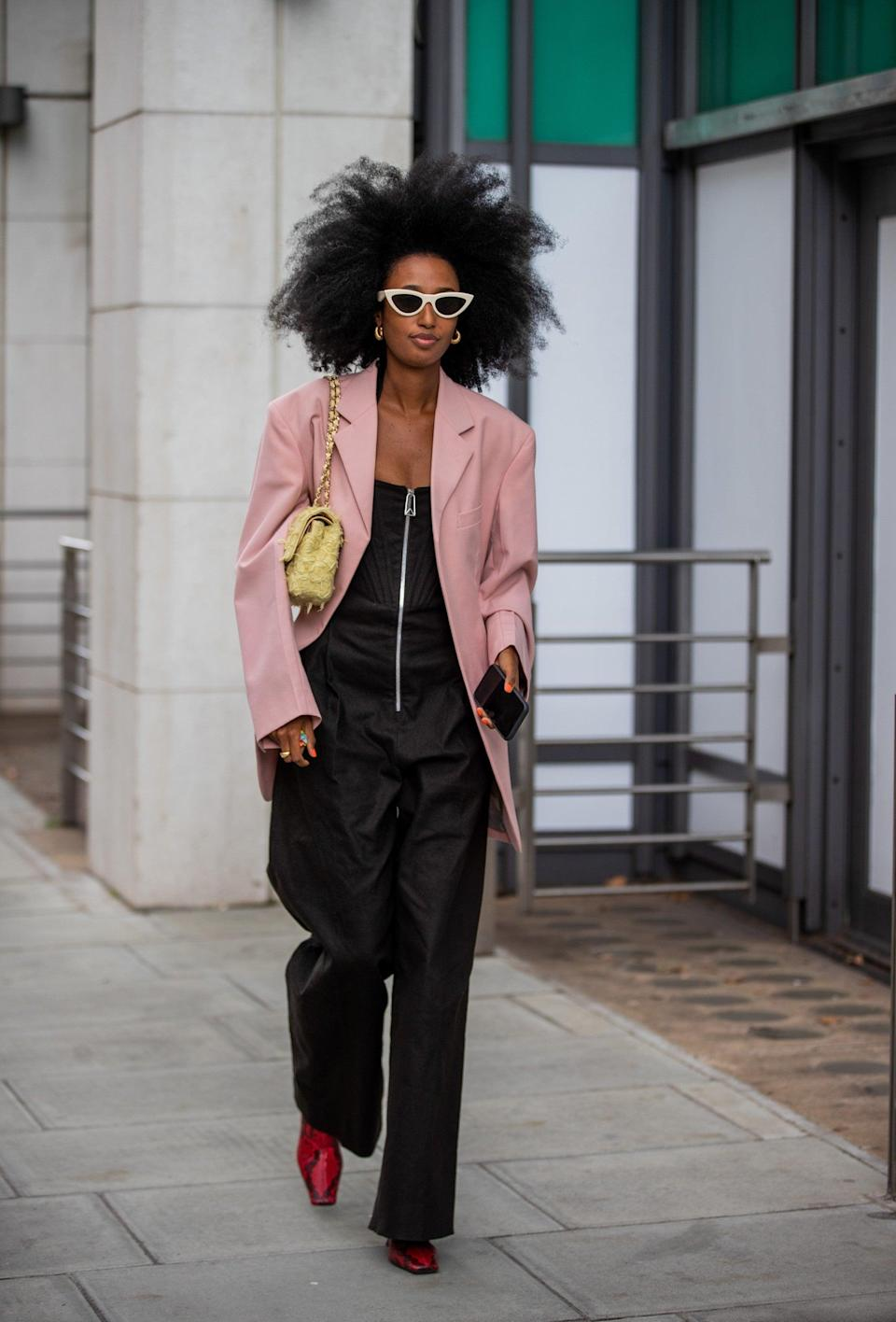 """This pink blazer-black jumpsuit combo is perfect for a warm September day, and a not-quite-so-warm September evening.<span class=""""copyright"""">Photo Courtesy of Christian Vierig/Getty Images. </span>"""
