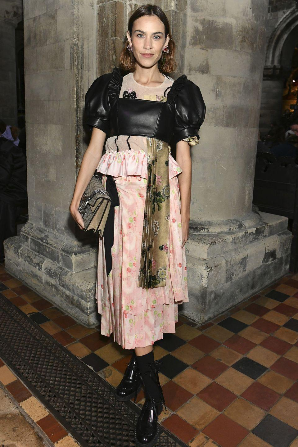 <p><strong>20 September </strong></p><p>Alexa Chung added an edge to her ensemble with a black leather crop top. </p>