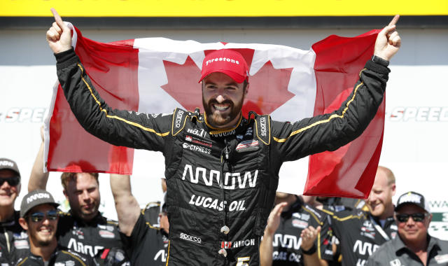 FILE - In this July 8, 2018, file photo, James Hinchcliffe celebrates after winning an IndyCar Series auto race at Iowa Speedway in Newton, Iowa. Hinchcliffe will return to Andretti Autosport for three races this season, including the Indianapolis 500. (AP Photo/Charlie Neibergall, File)