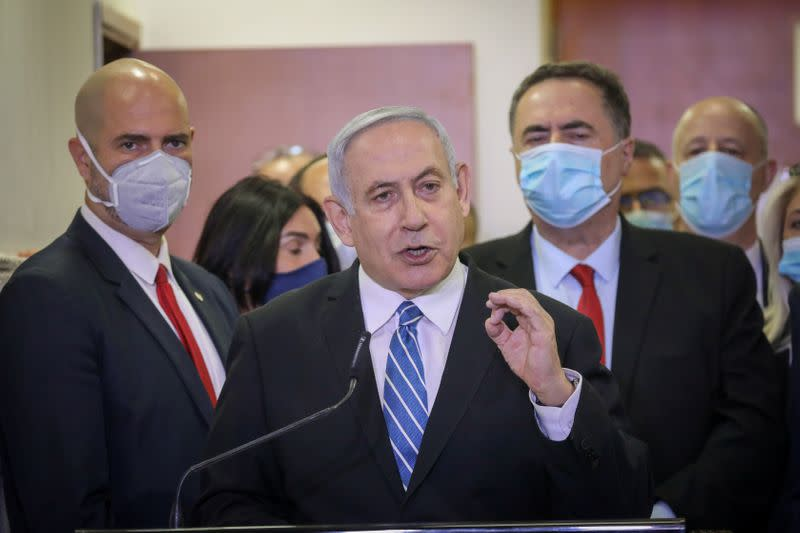 Defiant Netanyahu goes on trial in Israel charged with corruption
