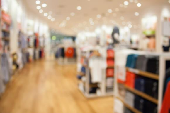 A blurry image of a department store interior.
