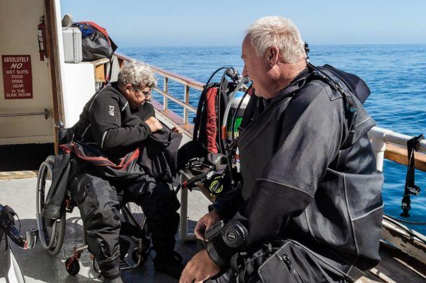 PHOTO: Dive Warriors Divemaster Kelly McCumiskey gears up before jumping into the ocean. (Gene Shabinaw)