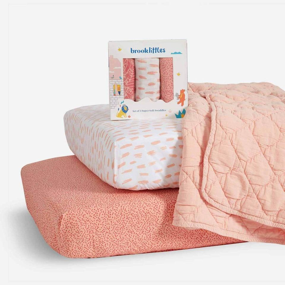 """<p><strong>Brooklinen</strong></p><p>brooklinen.com</p><p><strong>$158.00</strong></p><p><a href=""""https://go.redirectingat.com?id=74968X1596630&url=https%3A%2F%2Fwww.brooklinen.com%2Fproducts%2Fbaby-bundle&sref=https%3A%2F%2Fwww.countryliving.com%2Fshopping%2Fgifts%2Fg34387013%2Fgifts-for-babies%2F"""" rel=""""nofollow noopener"""" target=""""_blank"""" data-ylk=""""slk:Shop Now"""" class=""""link rapid-noclick-resp"""">Shop Now</a></p>"""