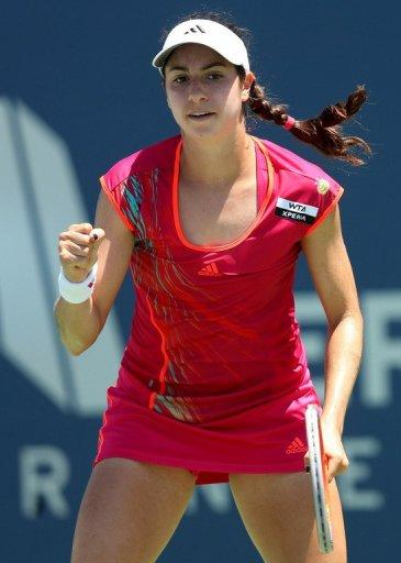 Christina McHale showed her fighting qualities as she recovered to beat Misaki Doi after nearly three hours
