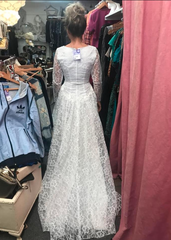 The dress was a thrift shop find she picked up just one day after getting engaged. Photo: Facebook/cat.wilkinson.56