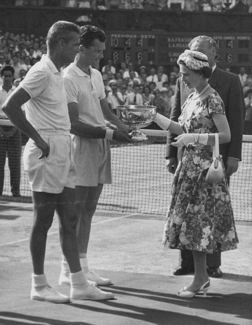 The Queen presents the Wimbledon Men's Doubles trophy to Gardnar Mulloy and Budge Patty, July 1957 - Paul Popper/Popperfoto via Getty Images