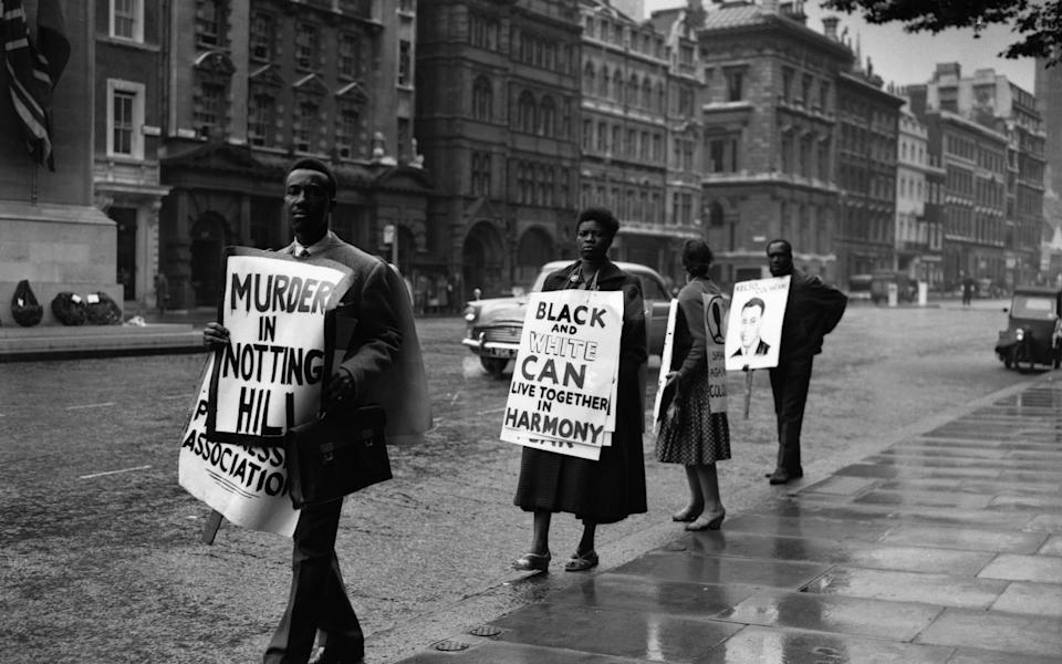 A demonstration in Whitehall, London, organised by the Coloured People's Progressive Association. The protesters carry posters and placards including a picture of Kelso Cochrane, a black man murdered in Notting Hill recently. (Photo by © Hulton-Deutsch Collection/CORBIS/Corbis via Getty Images)  - Getty