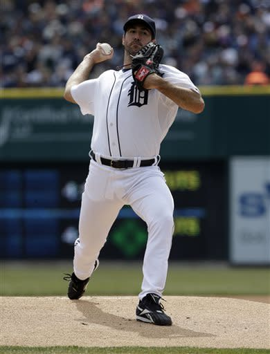 Detroit Tigers starting pitcher Justin Verlander throws during the first inning of a baseball game against the New York Yankees in Detroit, Sunday, April 7, 2013. (AP Photo/Carlos Osorio)