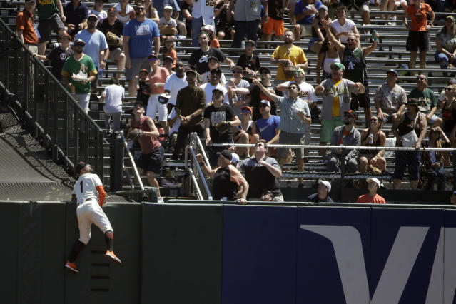 San Francisco Giants center fielder Kevin Pillar (1) looks up at a solo home run hit by Oakland Athletics' Matt Chapman during the first inning of a baseball game in San Francisco, Wednesday, Aug. 14, 2019. (AP Photo/Jeff Chiu)