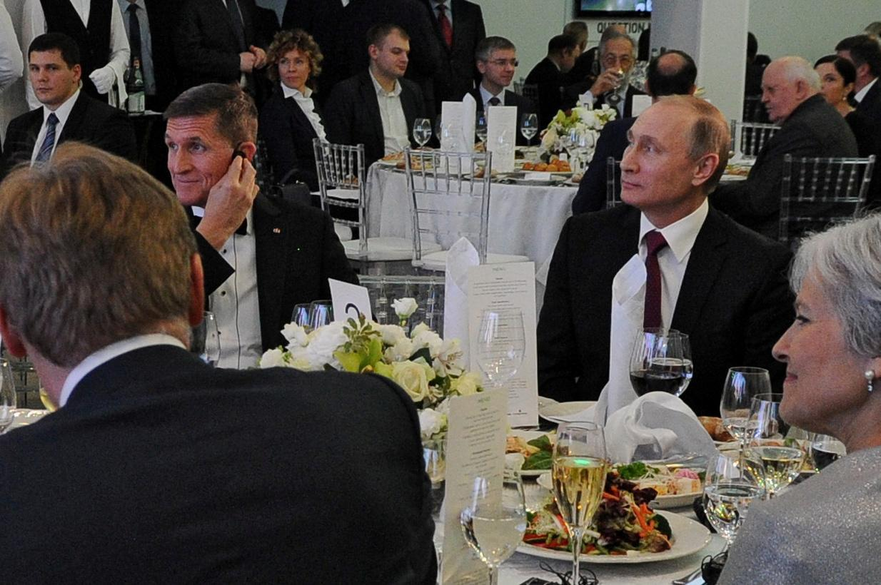 Russian President Vladimir Putin, right, sits next to Michael Flynn at an event in Moscow marking the 10th anniversary of RT, the Kremlin-backed television channel, December 2015. (Photo: Sputnik/Mikhail Klimentyev/Kremlin via Reuters)