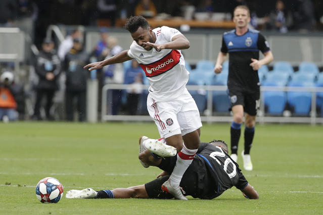 Chicago Fire midfielder Mo Adams, top, chases the ball over San Jose Earthquakes midfielder Anibal Godoy during the second half of an MLS soccer match in San Jose, Calif., Saturday, May 18, 2019. (AP Photo/Jeff Chiu)