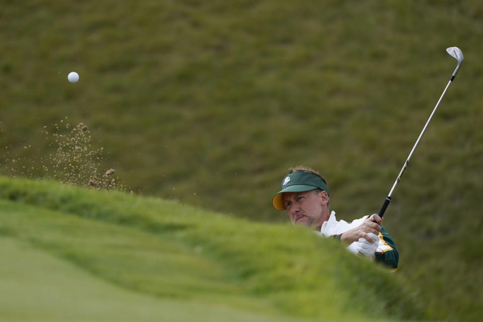 Team Europe's Ian Poulter hits from a bunker on the sixth hole during a practice day at the Ryder Cup at the Whistling Straits Golf Course Wednesday, Sept. 22, 2021, in Sheboygan, Wis. (AP Photo/Jeff Roberson)