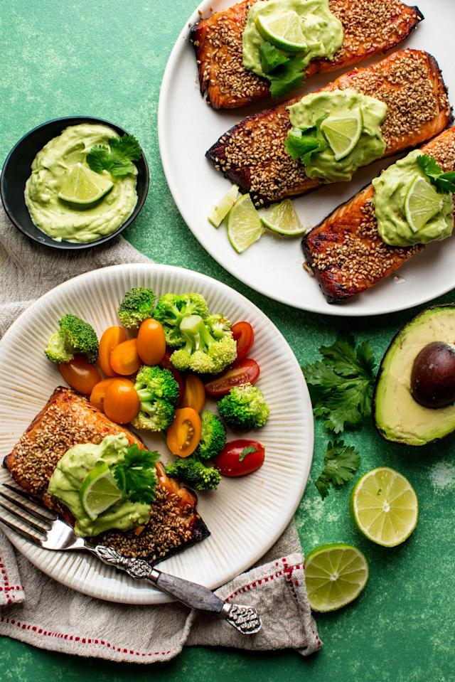 """<p>Spice up your dinner with crisp sesame salmon served with a thick, cool, and creamy avocado lime sauce!</p><p>Get the recipe from <a href=""""http://www.delish.com/cooking/recipe-ideas/recipes/a53444/creamy-avocado-lime-salmon-recipe/"""" rel=""""nofollow noopener"""" target=""""_blank"""" data-ylk=""""slk:Delish"""" class=""""link rapid-noclick-resp"""">Delish</a>.</p>"""