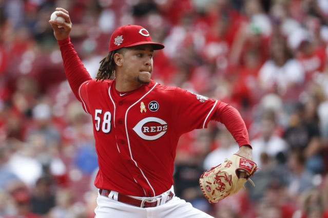 Cincinnati Reds starting pitcher Luis Castillo throws in the first inning of a baseball game against the Arizona Diamondbacks, Saturday, Sept. 7, 2019, in Cincinnati. (AP Photo/John Minchillo)