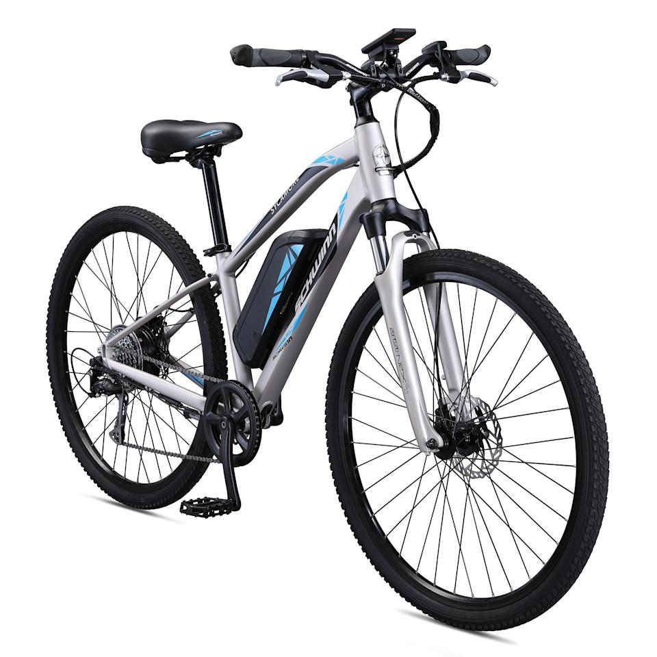 "<h3>Schwinn Sycamore Electric 8-Speed Mountain/Hybrid Bicycle</h3> <br><strong>Best For</strong>: <strong>Long Commutes </strong><br>If you are worried you are a bit far to make a morning commute by bike (or are too far to bike it without arriving sweaty and rumpled), this electronic bike from Schwinn is a great option. Choose from five different levels of pedal assists, and eight speeds, and travel as fast as 20 mph. You can pedal as hard (or as little) as you want to on your commute. <br><br><strong>Good to Know: </strong>A display by the handlebars lets you know how fast you're going. <br><br><strong>What Happy Bikers Say:</strong> ""I would recommend this to anyone looking for a solid, well-performing durable ebike for their commute or for leisure. It's a great ride and investment will save you on gas (and improve your health) in the long run, and is built to a standard that exceed[s] expectations.""<br><br><strong>Schwinn</strong> Sycamore Electric 8-Speed Mountain/Hybrid Bike, $, available at <a href=""https://go.skimresources.com/?id=30283X879131&url=https%3A%2F%2Fwww.walmart.com%2Fip%2FSchwinn-Sycamore-Electric-350-Watt-Hub-Drive-8-Speed-Mountain-Hybrid-Electric-Bicycle-Women-s-Small-Silver%2F908231713"" rel=""nofollow noopener"" target=""_blank"" data-ylk=""slk:Walmart"" class=""link rapid-noclick-resp"">Walmart</a><br><br><br><br><br><br>"